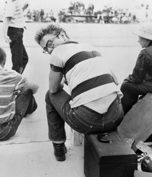 James Dean Looks Over Shoulder at Car Rally by Frank Worth