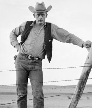 "James Dean standing at fence on set of ""Giant"""